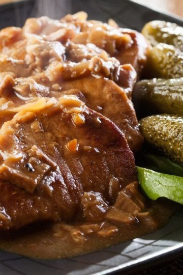 Slow Cooker Pork Roast with Mushrooms sliced on a plate