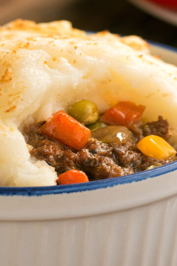 Closeup of Quick and Easy Stove-top Shepherd's Pie in a blue and white bowl