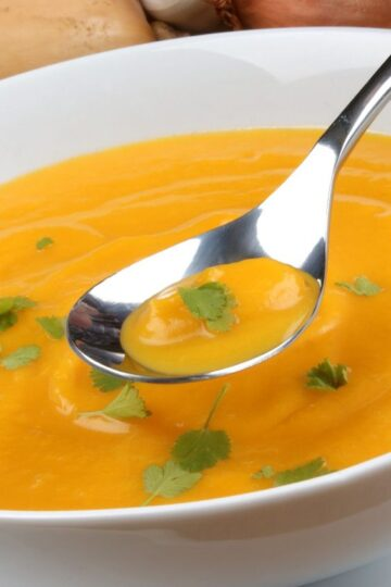 Bowl of Butternut Squash soup in a white bowl.