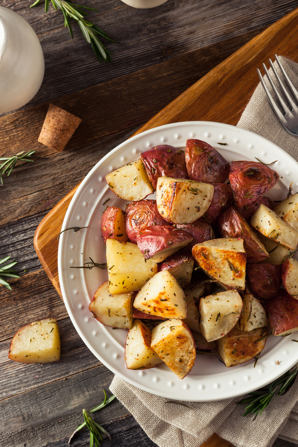 Rosemary Roasted Red Potatoes in a white bowl on a wooden table